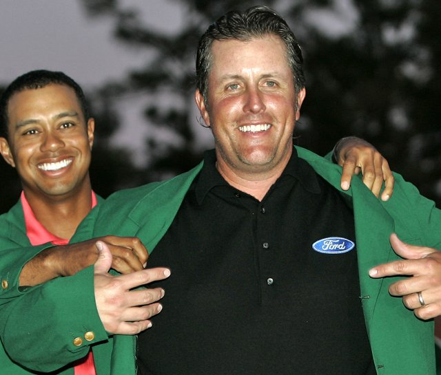 Phil Mickelson dons the green jacket after winning the 2006 Masters.