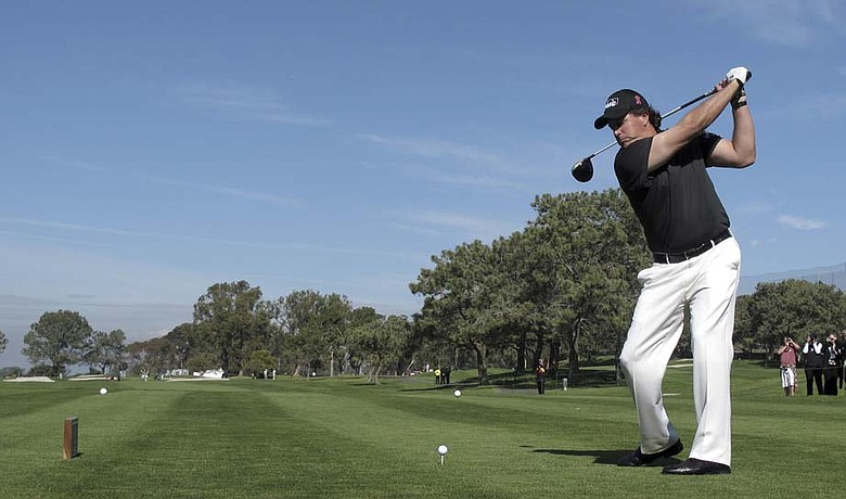Phil Mickelson tees off during the pro-am for the Farmers Insurance Open Wednesday at Torrey Pines.