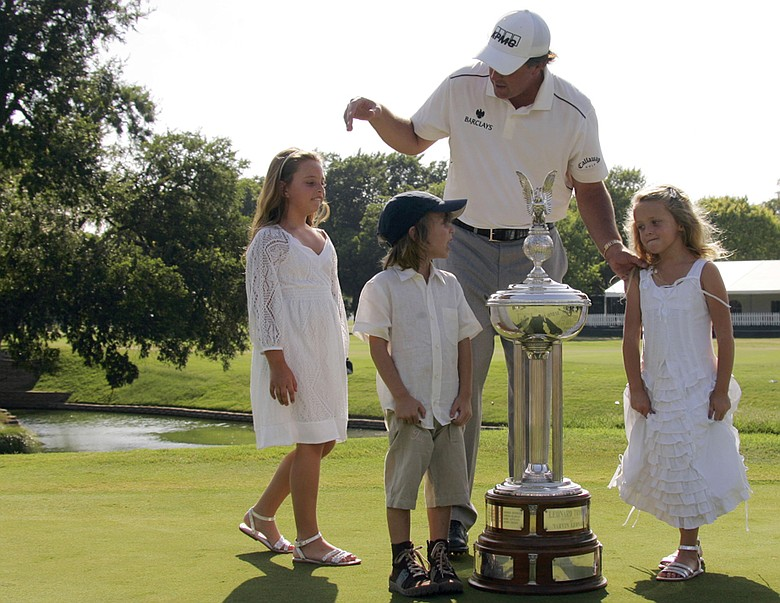 Phil Mickelson with his children, Amanda, left, 8 Evan, center, 5 and Sophia , 6, after he won the 2008 Colonial.