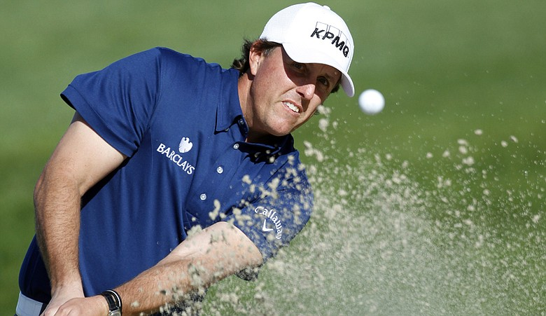 Phil Mickelson plays out of a bunker at the Farmers Insurance Open.