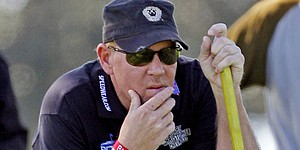 Daly misses cut, says he's quitting golf
