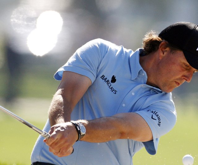 Phil Mickelson responded to accusations of &quot;cheating&quot; by using old Ping Eye 2 wedges at the Farmers Insurance Open.