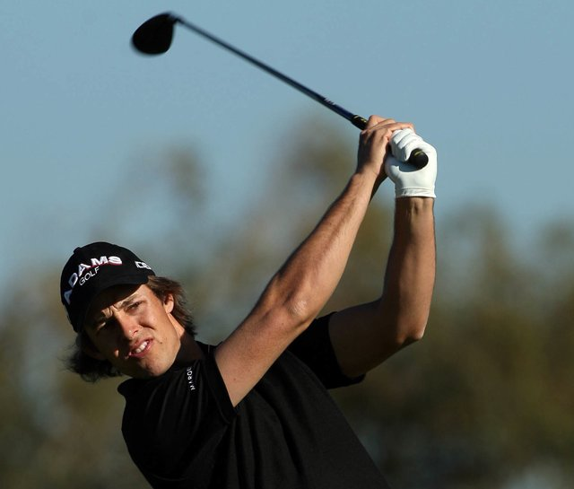 Aaron Baddeley tees off at Torrey Pines wearing Travis Mathew.