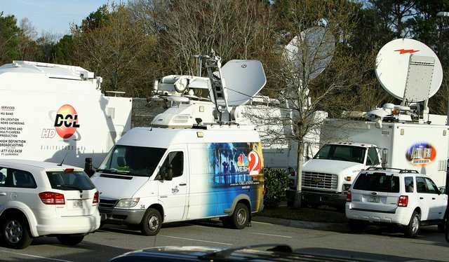 Satellite trucks en mass are parked outside Sawgrass at Marriott in Ponte Vedra Beach, Fla. for Tiger Woods' first public statement in three months.