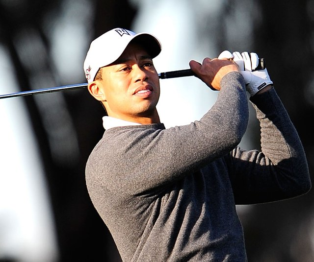 Tiger Woods practices golf the day before making a public statement at TPC Sawgrass.