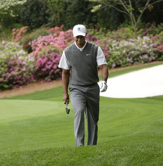 Tiger Woods walks off the 13th green at Augusta National during a practice round at the 2008 Masters.