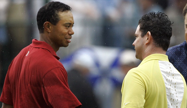 Tiger Woods and Rory Sabbatini shake hands after the 2007 Bridgestone Invitational.