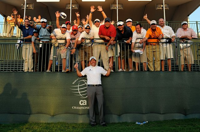Phil Mickelson celebrates with a group of fans after winning the 2009 WGC-CA Championship.