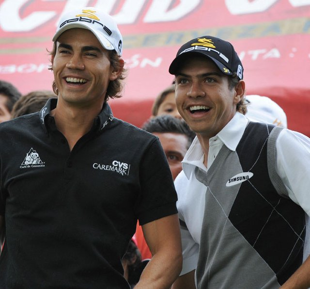 Camilo Villegas (left) and his brother Manuel smile during a golf exhibition on March 18, 2009, in Bogota.
