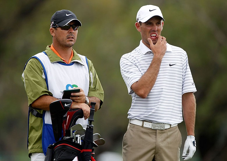 Charl Schwartzel talks with his caddie, Wynad Stander, on the fifth tee Thursday at Doral.