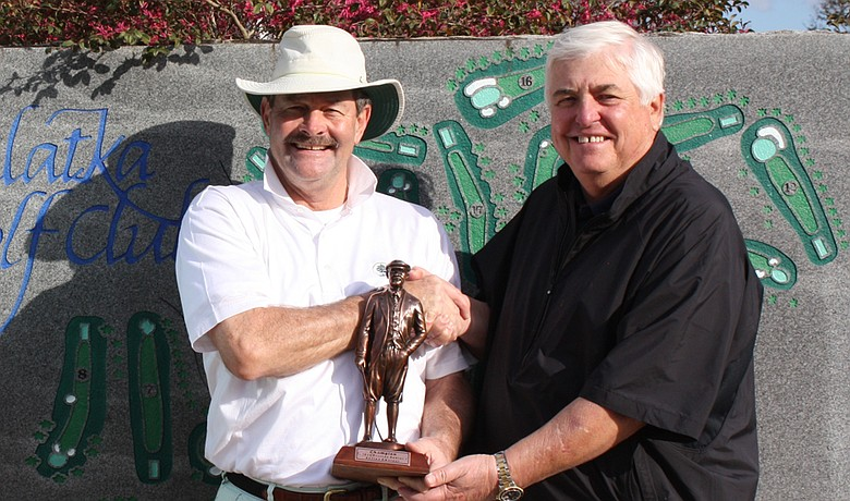 Rick Woulfe (left) accepts the Florida Azalea Senior Amateur trophy.