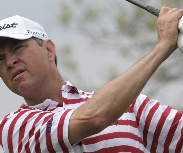 Davis Love III holds a share of the first-round lead with J.B. Holmes at the Arnold Palmer Invitational.