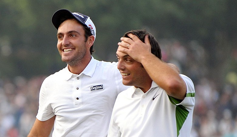 Italian brothers Francesco (right) and Edoardo Molinari celebrate after winning the World Cup of Golf in 2009.