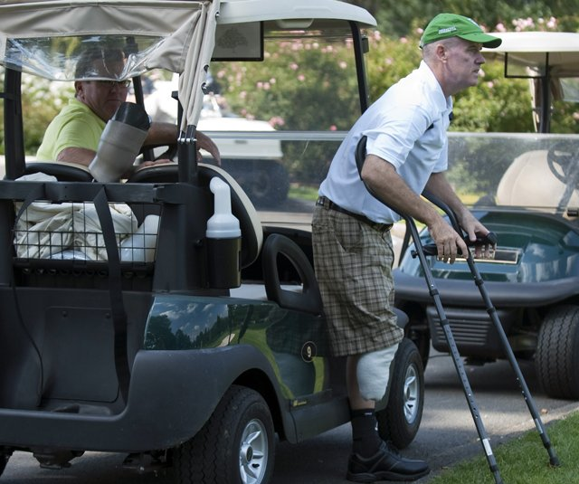 Ken Green prepares to walk from a golf cart at a charity golf tournament on Sept. 28, 2009, at the Ridgewood Country Club in Danbury, Conn.