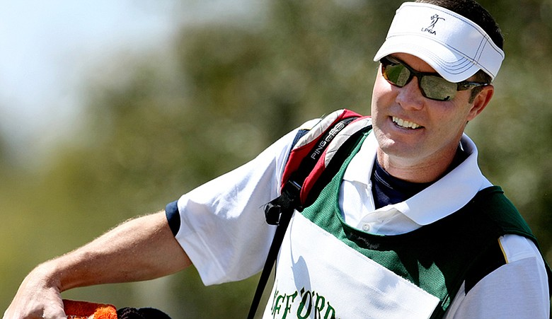 Mike Whan caddied for Futures Tour player Lili Alvarez at the Florida's Natural Charity Classic.