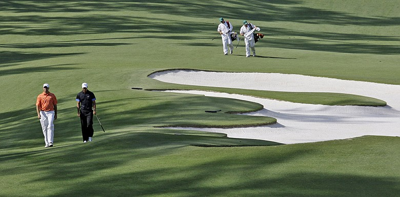 Tiger Woods and Stewart Cink walk down the 10th fairway at the 2009 Masters.