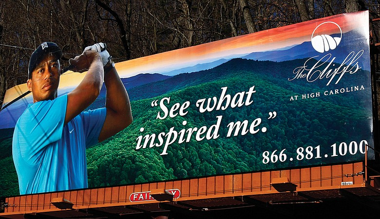 Tiger Woods appears on a billboard touting The Cliffs at High Carolina.