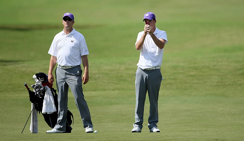 Washington coach Matt Thurmond (left) and Nick Taylor at the Isleworth Collegiate Invitational last October.