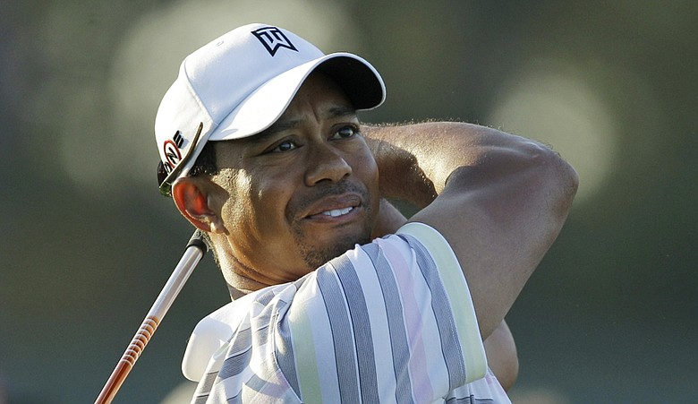 Tiger Woods hits a shot at Augusta Monday during a practice round.