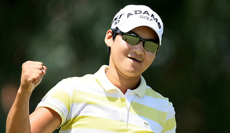 Yani Tseng pumps a fist at No. 8 during the final round of the Kraft Nabisco Championship.