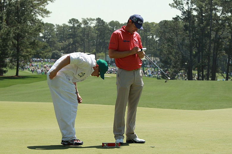 Padraig Harrington studies a green with his caddie Ronan Flood Tuesday at Augusta National.