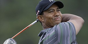 Changing conditions greets Woods on first tee
