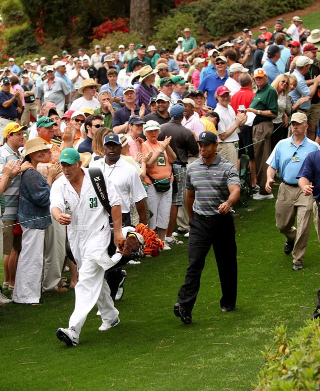 Tiger Woods and his caddie Steve Williams walk to the seventh tee Thursday.
