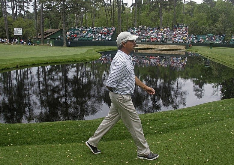 Fred Couples walks to the 15th green during the first round of the Masters.