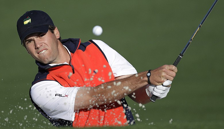 Ben Martin plays a shot out of a bunker at the Masters.