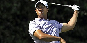 Woods wins battle to stay in contention