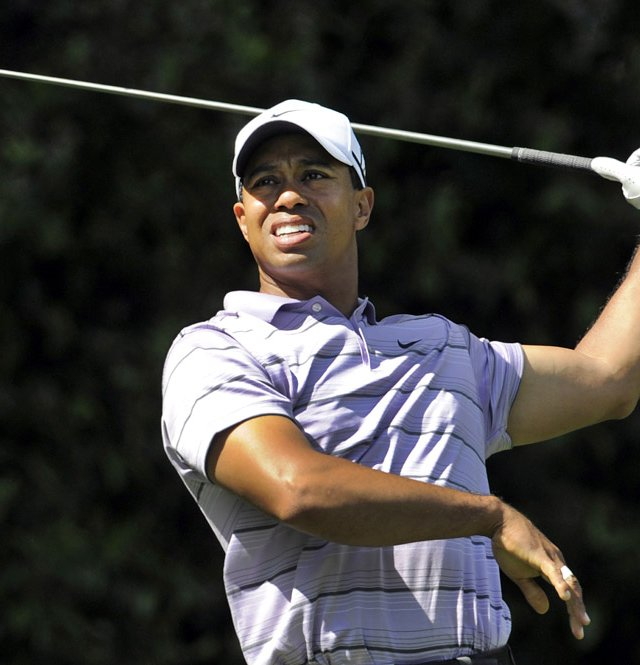 Tiger Woods hits an errant drive on the fith hole during the third round of the Masters.