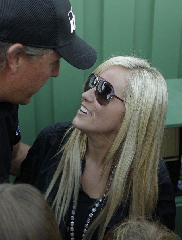 Phil Mickelson is met by his wife, Amy, and family after winning the Masters.
