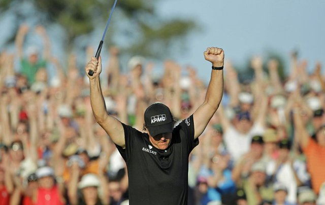Phil Mickelson reacts after winning the 2010 Masters.