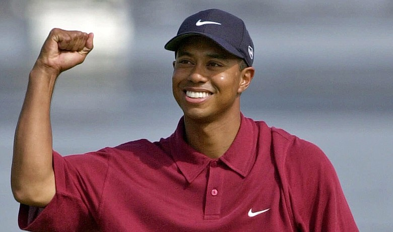 Tiger Woods celebrates after winning the 2000 U.S. Open at Pebble Beach.