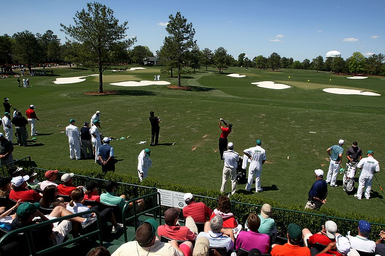 Players warm up on the new practice facility at Augusta National prior to the final round of the 2010 Masters.