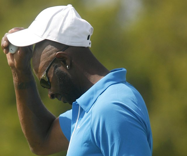 Jerry Rice reacts to a bogey at the Nationwide Tour's Fresh Express Classic.