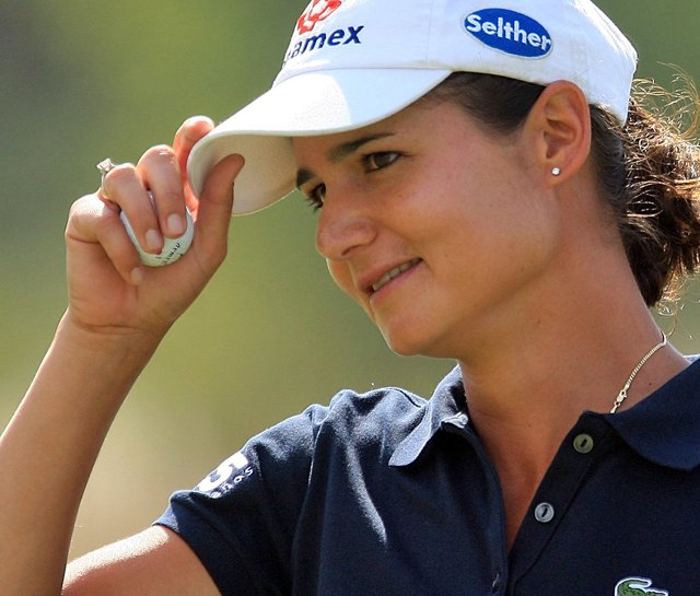 Lorena Ochoa smiles during the second round of the 2009 MasterCard Classic in Huixquiucan, Mexico.