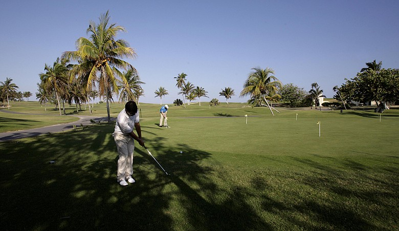 Players hit the practice green during the 2010 Montecristo Cup Golf Tournament in Varadero, Cuba
