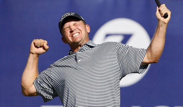 Jason Bohn celebrates on the 18th green after winning the Zurich Classic.