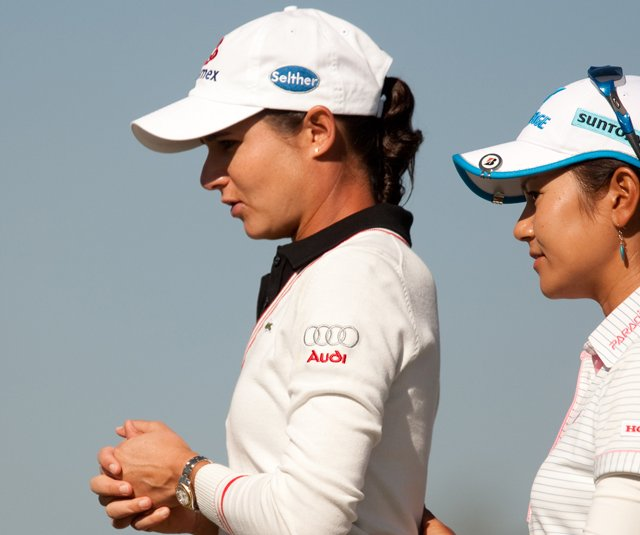 Lorena Ochoa and Ai Miyazato stand on the tee together during the Tres Marias Championship.