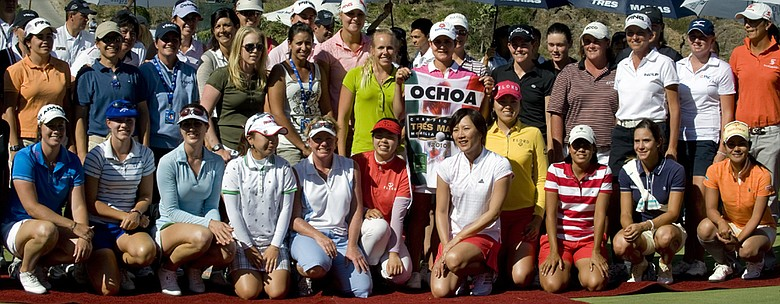 Lorena Ochoa (center) poses for a picture holding a caddie vest she received as a farewell present after the Tres Marias Championship.
