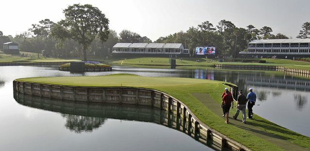 Tiger Woods, Pat Perez, J.J. Henry and Steve Williams walk to the 17th green during a practice round for The Players.