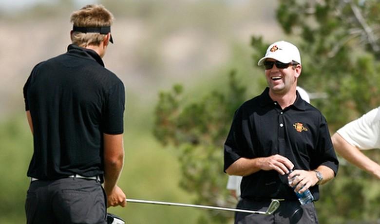 San Diego State coach Ryan Donovan (right) jokes with his team.