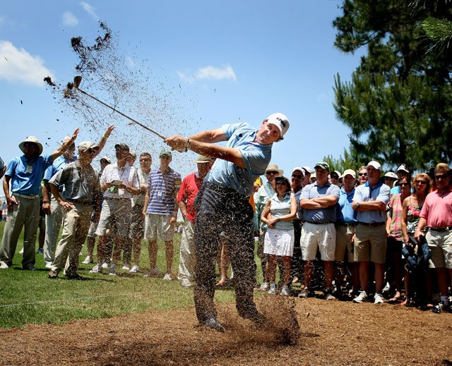 Phil Mickelson hits his second shot from pine straw at No. 16 Saturday at The Players.