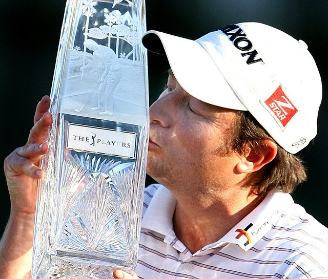 Tim Clark kisses the trophy after winning The Players Championship.