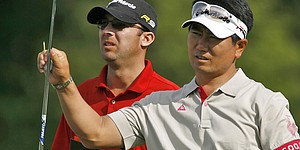 Yang drops caddie over 'chemistry issues'