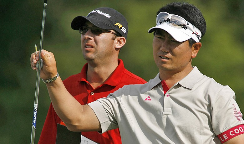 Y.E. Yang and caddie A.J. Montecinos at the 2009 Deutsche Bank Championship.