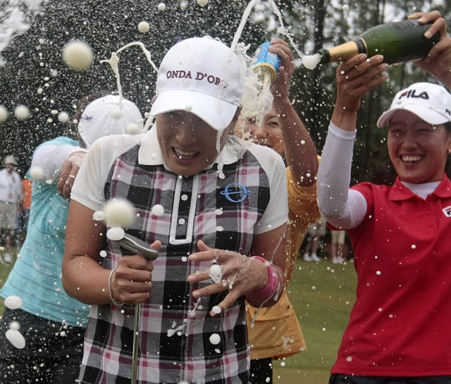 Se Ri Pak gets doused with Champagne after winning the Bell Micro LPGA Classic.
