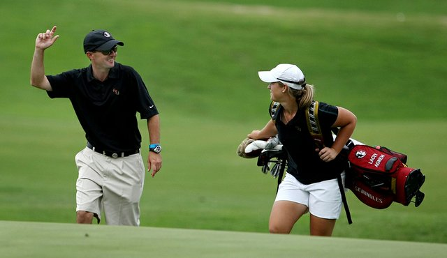 Assistant coach Chris Malloy walks with senior Lacey Agnew at the 18th.