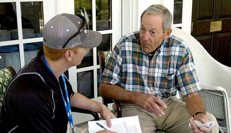 Golfweek's Asher Wildman interviews Country Club of Landfall member Bill Stauffer at the NCAA Women's Championship.